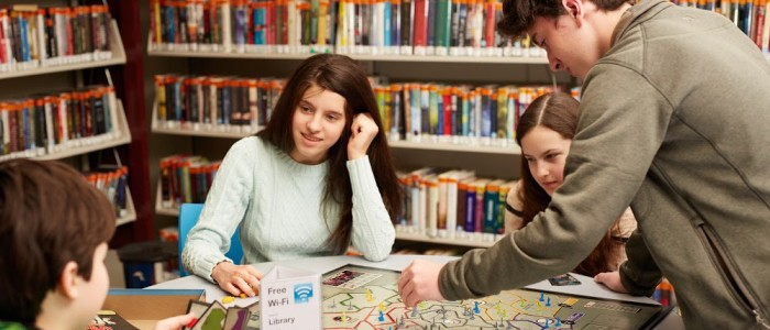 Teens playing board games in the library's Teen Room